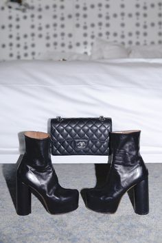 Inside Envelope.no's Founder's Closet: Small black quilted bag with silver details by Chanel, Black Platform Ankle Boots by Vetements | coveteur.com