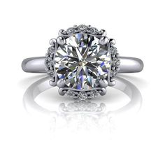 Lab grown genuine diamond halo engagement ring. *GEMSTONES: 7.5mm,1.50 ct round Colorless moissanite, DEF Color, VVS Clarity. Lab grown genuine diamonds, F Color, VS Clarity, .17 ct. *Band width 2mm. *Our Moissanite is purchased in the USA. Stone arrives with a warranty card/certification of authenticity. Online registration is recommended.*The ring is custom made just for you in your ring size and metal preference. It is offered in solid gold, and solid platinum. Other metals are available upon