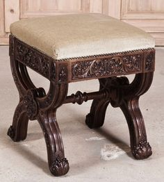 Sculpted from dense, old-growth French oak in the timeless Gothic manner, this footstool features carved embellishment over the entirety of its facades, including the insides of the legs, which are connected together with a turned stretcher. Elaborate foliates, moorish arches and fleurs de lys appear in the design, with a glorious quatrefoil rosette at the juncture of the legs on each side as a centerpiece. Upholstered in neutral-colored velvet recently so there's no need to replace the…
