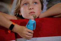 Nine-year-old Belle Shefrin holds a Clinton doll while listening to the first female presidential candidate for a major political party speak at a campaign rally in Akron, Ohio on October 3.