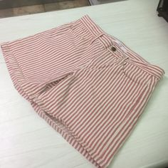 """Joe's Jeans cotton red and cream  striped shorts Cute muted red and creamy white classic flat front style board shorts.  Soft cool cotton  with some stretch for a nice fit.  Pair these with a tank and your favorite flips and you're ready for the day they're really cute with the legs rolled up as well.  Size 27. Waist measures 15"""" flat across the front.  Inseam is 5.5"""".  Rose is 8"""" Joe's Jeans Shorts"""