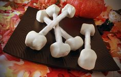 "SOH Pretzel Rods, Cake Mate Easy Squeeze Decorator's White Icing or Melted White Chocolate, Lg Marshmallows. Line cookie sheet with wax paper. If using icing squeeze tube of icing into a microwave-safe bowl & microwave at full power in 20 second intervals stirring between intervals,  until icing is pourable. Snip an ""X""  into the middle of marshmallows. Insert a prepared marshmallow on each end of pretzel rod. Coat each bone with the melted icing or chocolate. Set on cookie to sheet to dry."
