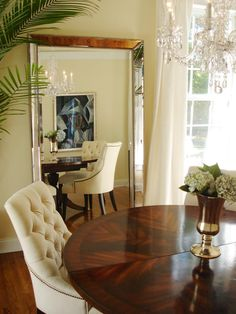 A favorite accessory for anyone decorating a small room, mirrors make a space appear larger and create appealing views, especially when placed across a favorite piece of artwork, cool furnishings or a well-designed display. Design by RMSer TheSharps.