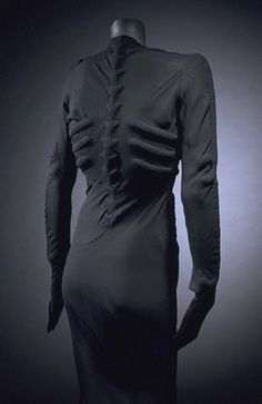 Elsa Schiaparelli. Dali helped design this skeleton dress.