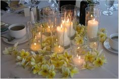 roses from freshroses.com. $4 for a 5″ a white frosted cylinder vase from Jamali Garden. $6-$7 for 6-8 pale yellow frosted glass cylinder votives with ivory candles. The hall added their own clear glass votives so each table was a little different. The roses were cut down to be quite low so the guests could talk. I thought about putting rose petals on the tables but decided it would look like the roses were falling apart! Got compliments on my florist's nice job. ;) And all the centerpieces…