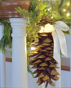 Greenery and sugar pinecones tied with white ribbon.  Simple & gorgeous...