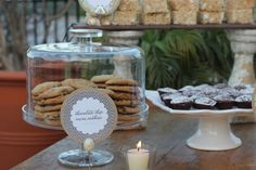 I love the idea of having cookies and brownies at a wedding displayed on cake stands.  It makes serving so easy.  Especially when the venue charges a cake cutting fee.