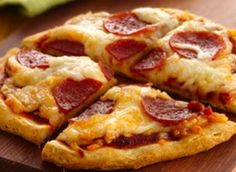 Grands Mini Pizza-so much fun with children!  Everyone gets their own biscuit to smash and build a pizza on top!