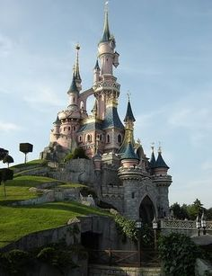 Disneyland Paris  Sleeping Beauty's castle! it looks exactly like it does in the movie!!!! complete with the rectangle shaped trees!