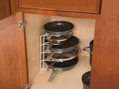 cabinet and drawer organizers Rubbermaid Pan Organizer (Makes life easier when you cannot stay bent over to untangle a stack of pots/pans). Kitchen Cabinet Organization, Kitchen Storage, Cabinet Organizers, Pan Storage, Kitchen Cabinets, Storage Ideas, Kitchen Tips, Kitchen Rack, Smart Kitchen