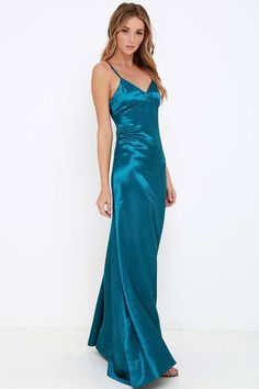 Live out your prime here and now with unforgettable designs like the Sleek of Success Teal Blue Satin Maxi Dress! Adjustable spaghetti straps made from teal blue satin support a fitted triangle bodice with gathered detail. Body-hugging silhouette continues into the A-line maxi skirt. Hidden back zipper with clasp.