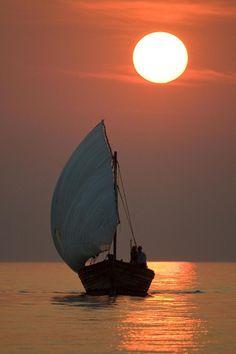 A sunset cruise on the traditional dhow at the Pumulani Luxury Beach Lodge, Lake Malawi, Malawi