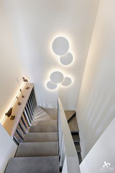 Beautiful #PuckWall art light designed by Jordi Vilardell at a duplex penthouse in Israel. Interior design by Dvirotem Interior Design. #lightingdesign #interiordesign #lighting