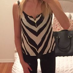 EXPRESS Black and White Striped Tank Blouse Cute under a blazer for work, or a leather jacket and black jeans at night. Worn once, perfect condition! *just realized there's a smudge on my mirror that looks like it's on the shirt and it's just the mirror!! I'll add a new pic tomorrow!** Express Tops Blouses