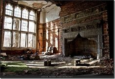 abandoned - what a beautiful old fireplace.