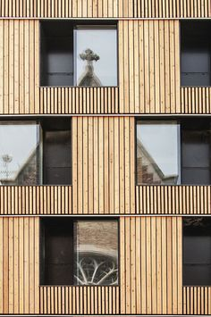 Technical and aesthetical renovation of an existing building in Mons historical city center housing 104 student dwellings for Mons University.