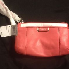 NWT Coach Leather Medium Wristlet-Coral Excellent new with tags never used. Authentic. Coach Bags Clutches & Wristlets