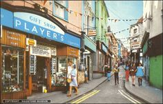 Folkestone -The Old High street much as I remember it as a child...a few doors up from the gift shop was a fabulous shop that sold good old fashioned jokes like itching powder! and taking the steep walk to the top was rewarded with the Rock shop where you watched them rolling rock through a huge window..mmm the smell was delightful!