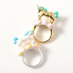 Add a touch of magic to your outfit with these unicorn rings by gargle. Two colors are available: silver (w/ warm yellow details and a pastel blue mane) and gold (w/ pastel pink details and a pastel teal mane). Each ring is a Japanese size 10. Matching unicorn necklaces are also available to complete the cute fantasy look.