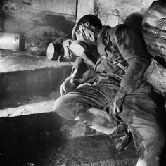 The photo by famous photographer Richard Peter sen. shows a corpse with a gas mask and a steel helmet in an air-raid shelter in Dresden, Germany, in 1946. Especially the bombing of Dresden by the Allies on 13 and 14 February 1945 led to an extensive destruction of the city. Photo: Deutsche Fotothek / Richard Peter sen.