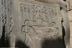 Relief of the dual God Hapi in the Luxor Temple. On the left is Hapi of Upper Egypt with the Lotus on his head, on the right Hapi of Lower Egypt with the Papyrus on his head. On the left face of the column is Seshat, the Goddess of Astronomy.