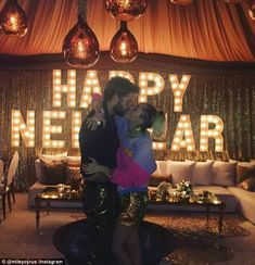 One passionate midnight kiss! Miley Cyrus and Liam Hemsworth looked more loved up than ever as they shared a passionate midnight kiss at a blended family New Year's Eve party in San Diego on Saturday