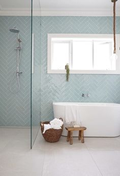 Functional bathroom, light and airy, with herringbone style tiles and a wet room floor