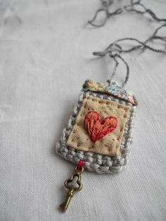 Embroidered heart crochet liberty fabric necklace by giovabrusa fabric crafts Embroidered heart, crochet, liberty fabric, necklace Fabric Beads, Fabric Art, Fabric Crafts, Crochet Fabric, Patchwork Fabric, Silk Fabric, Jewelry Crafts, Jewelry Art, Handmade Jewelry