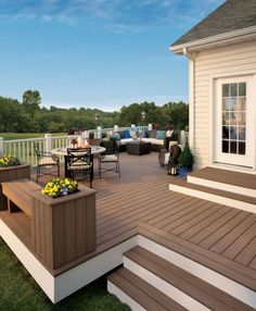 We need to paint our deck to look like this and add the white boards underneath. How fresh!