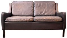 """Nicely worn leather loveseat straight off the boat from Denmark. This is dark brown leather with no rips, or tears. Worn in all the right places. c. 1960's..Leather cleaner or conditioner can be used to make worn areas less noticeable and good for the leather. Cushions have a zipper and covers can be removed from foam.   Back left leg has a small piece missing which has been colored in- see photos.Very comfortable, springs and structure are sound.  Measures: 49""""W, 30""""D....seat is 16"""" off…"""
