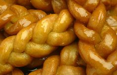 Koeksisters are a South African syrup-coated twisted doughnut that originally come from the Cape Malay community.    The Afrikaners have a slightly different koeksuster recipe that is more crispy and sweeter with more syrup on them.