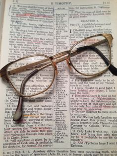 """16 """"All Scripture is inspired by God and profitable for teaching, for reproof, for correction, for training in righteousness; 17 that the man of God may be adequate, equipped for every good work.""""  II Timothy 3:16-17  My dad's Bible open to this passage in the KJV with an old pair of his glasses."""