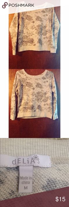 "Cream and Grey Floral Delia's Sweater Floral Delia's Sweater in size medium. True to size. Self: 54% Cotton, 46% Polyester. Rib: 62% Polyester, 32% Cotton, 5% Spandex. In like new condition with no flaws! Offers welcome.                                                         ✨Click ""Add to Bundle"" on 3 or more items to receive 20% off. Even if you only add one or two items, you may receive a special offer for me for further savings and no risk involved✨ Delia's Sweaters Crew & Scoop Necks"