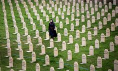 An Iraqi Kurd woman visits a graveyard for the victims of a gas attack by former Iraqi President Saddam Hussein in 1988, as people mark the 26th anniversary of the attack in the Kurdish town of Halabja on March 16. (AFP/Safin Hamed)