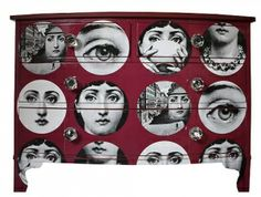 Fornasetti Faces Chest Of Drawers In Red by Bryonie Porter, the perfect gift for Explore more unique gifts in our curated marketplace.