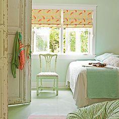 Jellyfish-printed curtains and a zebra-striped beanbag add a dash of whimsy to this mint green and orange bedroom.