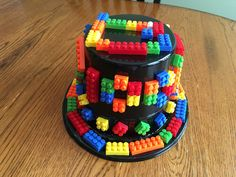 CJ's 100th day of school hat project. It cost $6. $1 top hat from Party City and $5 bag of imitation Legos from the party section at Target. He wrote out 100 with the Legos on the front of the hat, his name on top, class # on back, and went crazy decorating the hat with the remainder of the 100 Legos.