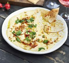 Lemony spiced houmous. Jazz up shop-bought houmous with harissa, herbs and lemon for a quick and easy party dip. Serve with toasted flatbreads and raw vegetables