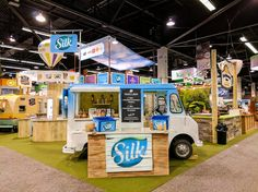 WhiteWave Foods' Silk sampling truck at the Natural Products Expo West show. Condit sourced and retrofitted this old milk truck to be showcased at the food festival-inspired trade show exhibit at NPEW.