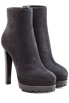 Pitch+black+suede+informs+the+towering+platform+silhouette+of+these+heeled+'Aspen'+boots+from+Sergio+Rossi+#Stylebop