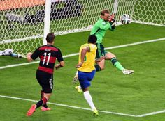 Brazil v Germany: Semi Final - 2014 FIFA World Cup Brazil BELO HORIZONTE, BRAZIL - JULY 08: Manuel Neuer of Germany makes a save at a shot at goal by Paulinho of Brazil during the 2014 FIFA World Cup Brazil Semi Final match between Brazil and Germany at Estadio Mineirao on July 8, 2014 in Belo Horizonte, Brazil. (Photo by Jamie McDonald/Getty Images)