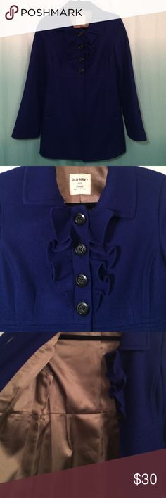 Old Navy-size S, gorgeous cobalt blue coat Old Navy-size S, gorgeous cobalt blue coat. Features a 4 button closure and ruffles at chest area. Has a beautiful golden bronze lining. Has two deep pockets on front. Shell is 60% wool, 25% polyester, 15% rayon. Lining is 100% polyester. In excellent condition. Back of collar to bottom of hem is approx. 30 inches. Old Navy Jackets & Coats Pea Coats