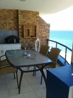 ENJOY BEATIFUL SEA VIEWS - Watch the dolphins swim by from this immaculate fully furnished apartment. The unit is on the floor of a very well run and secure building and has a lift. It also comes with undercover and visitor's parking. Fully Furnished Apartments, Outdoor Tables, Outdoor Decor, Flat Rent, Very Well, The Unit, Outdoor Furniture, Flooring, Undercover
