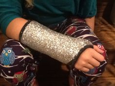 How to bling an arm cast: 3 alternating layers of Modge Podge and glitter. Top with 4+ coats of Aleene's spray acrylic sealer to keep the glitter in place. It all dries very quickly.
