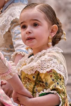 Little Spanish girl in Fallera dress from Valencia