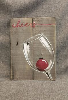 Christmas wine, Pallet wall Art decor, red Christmas bulb, Christmas decor, reclaimed wood, Distressed wine glass, handpainted  Original Acrylic painting on reclaimed pallet wood that is stained with a gray water-based stain.  This unique piece is 15 in x 11 in. Give your kitchen or bar area a personal, shabby chic touch with this rustic artwork for the holidays.  All of my creations are made of reclaimed boards. They are hand painted and are made after they are ordered. Although I try to…
