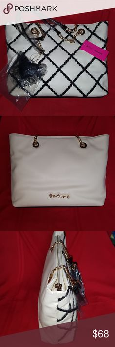 NEW Betsey Johnson Tote Bag w/ Heart Hangbag MINT Authentic Betsey Johnson White Tote Bag with black ruffled lattice on front, chain handles, goldtone hardware, heart charm accent, lined, pvc, top zip closure. Photo is actual item that will come to you brand new with tags and original packing in mint condition. This item is closet kept and from a smoke and pet free environment. I am the original owner and purchased this item new from a fine retail store. Packed and ready to ship…