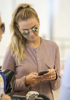 Still on display: On Monday Perrie arrived at LAX with her engagement ring firmly in place...