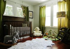 Gender Neutral Nursery full of forest friends and a fab lambskin rug!