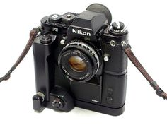 1980 Nikon F3 with an MD-4 motor and accessory shutter button. This camera has an electronically controlled shutter but the mirror and film transport are still mechanical. This early F3 has a Nikkor Series E f1.8 / 50mm lens.